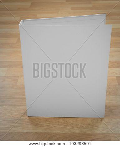 White  folder on wood
