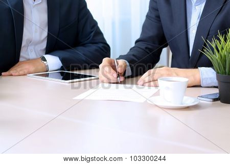 Business Colleagues Working Together. Businessman Is Signing A Contract