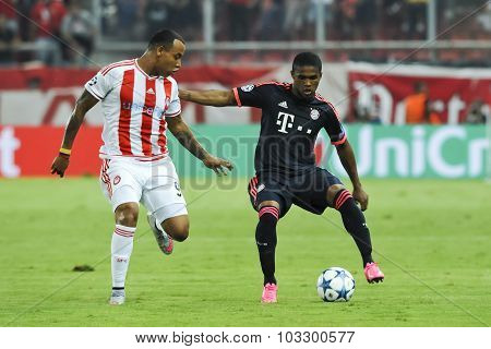 Douglas Costa (r) And Alfred Finnbogason (l) During The Uefa Champions League Game Between Olympiaco