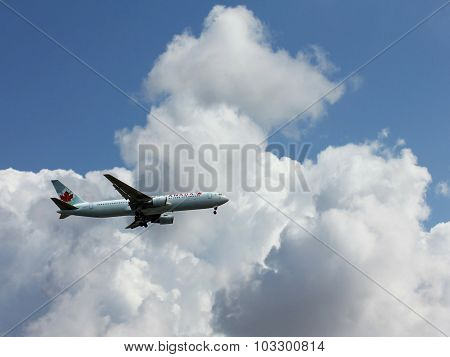 Air Canada Plane Is Preparing To Land At Ben Gurion Airport On A  White Clouds And Blue Sky Backgrou
