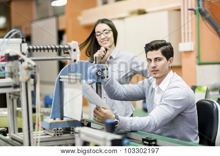 Two Young Students Working On A Project Together In Lab