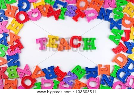 Teach Written By Plastic Colorful Letters On A White