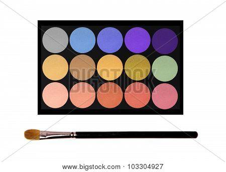 Set Of Eyeshadows And Brush Isolated On White Background