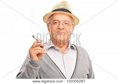 Joyful mature man holding a joint and looking at the camera isolated on white background