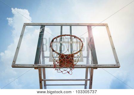 Basket Hoop Light Flare On The Sky.
