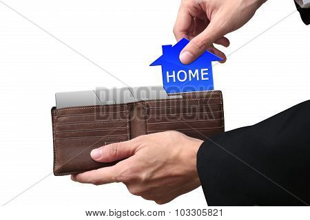 Businessman Hands Pulling Pay Home Concept On Brown Wallet.