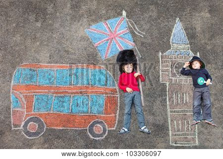 Two Kid Boys In British Soldier Policeman Uniform With London Pi