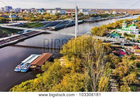 Pedestrian Lovers Bridge on Tura river. Tyumen