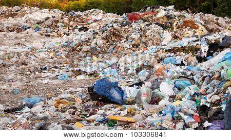 Junkyard Of Domestic Garbage. Large Heap Of Garbage.