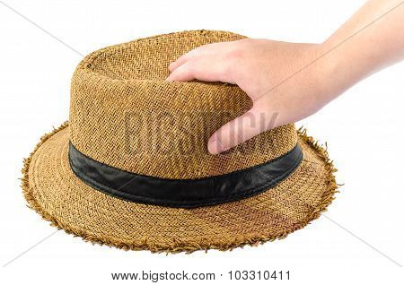 Man Holding A Straw Hat  In His Hand