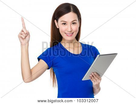 Woman use of the tablet pc and finger point up