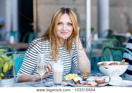Young Woman Having Healthy Breakfast In Outdoor Cafe