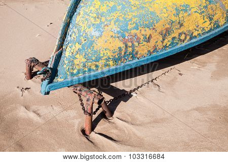 Old Rowboat Lays On Sandy Beach, Bow Fragment