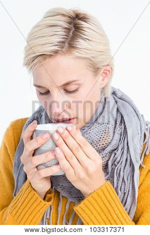 Close up of woman drinking from a cup to feel better