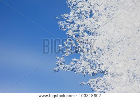 Abstract image of thin ice on blue sky background