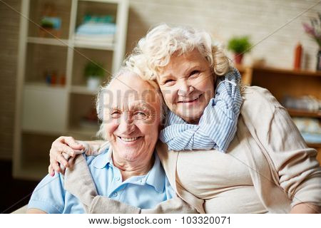 Happy retired couple looking at camera