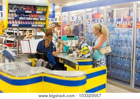 Customers paying for shopping at a supermarket