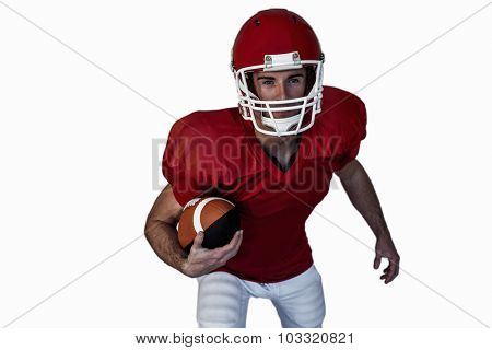Player posing with rugby ball over white background