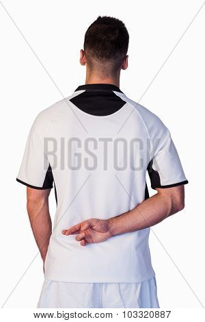 Rear view of rugby player with fingers crossed over white background