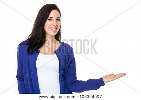 Brunette woman with hand showing something