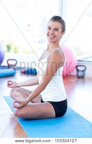 Portrait of a woman happy woman doing meditation in fitness studio