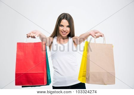 Portrait of a smiling girl holding shopping bags isolated on a white background
