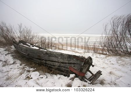 Old rotten boat on the beach