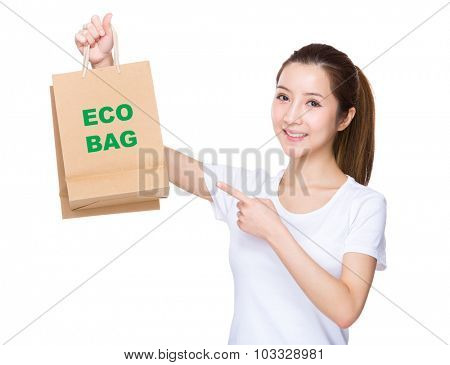 Woman finger point to shopping bag and showing phrase of eco bag