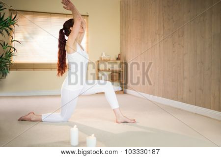 Side view of woman meditating with joined hands at spa