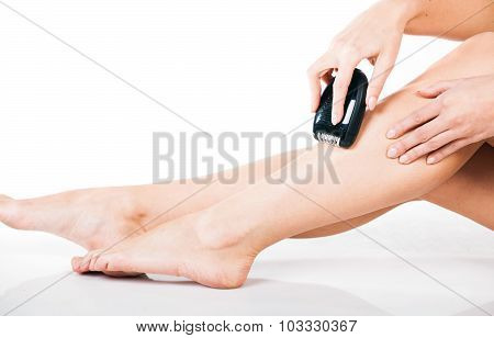 Woman Shaving Legs With Electric Shaver Depilator
