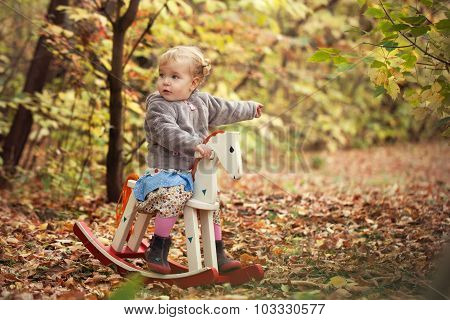 Little Cute Beautiful Girl Walks In Autumn Park