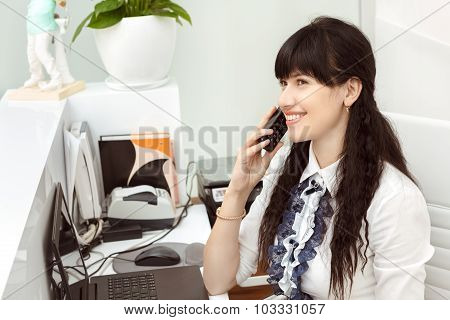 Beautiful girl at the reception answering call