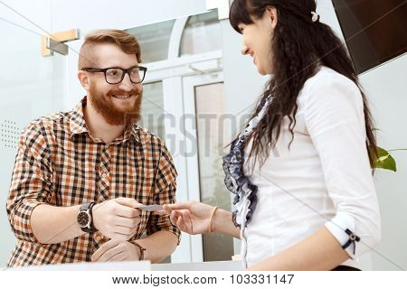 Office manager giving the customer a business card