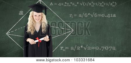 Teenage Girl Celebrating Graduation against green chalkboard