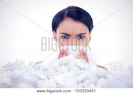 Sick gorgeous model blowing her nose against used tissues