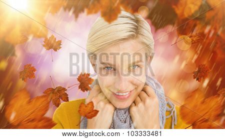 Smiling woman wearing a scarf against dark abstract light spot design