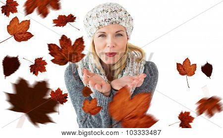 Happy winter blonde against autumn leaves