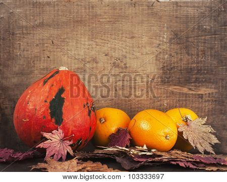 Pumpkin, Oranges And Dry Maple Leaves