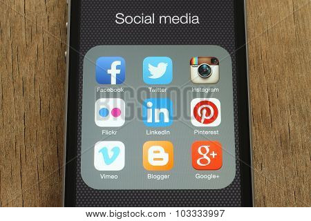 iPhone with popular social media icons on its screen