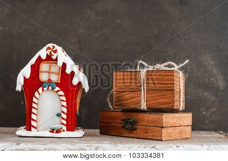 Gingerbread House And Wooden Gift Boxes
