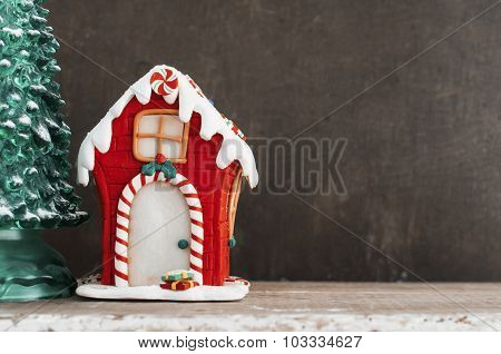 Red Gingerbread House And Christmas Tree