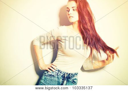 Woman With Long Hair In High Waisted Jeans