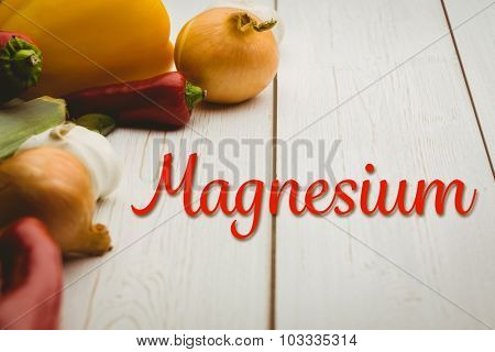 magnesium against vegetables on wooden table