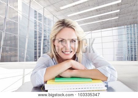 Mature student smiling against modern room overlooking city