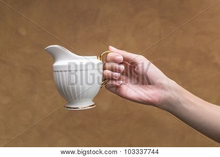 Holding A Small Pitcher