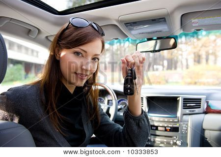 Successful Woman With Keys From  Car