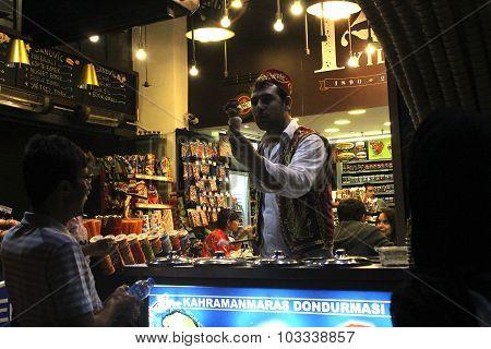Turkish seller sale icecream to a man on the street