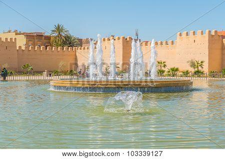 TAROUDANT, MOROCCO, APRIL 9, 2015: Big fountain in front of historic ramparts