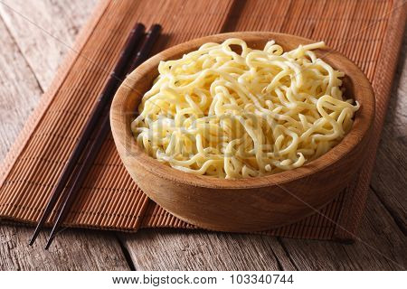 Asian Ramen Noodles In Wooden Bowl Close-up. Horizontal