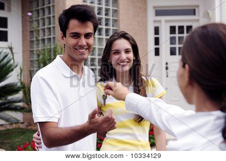 Real Estate Agent Handing Over House Key